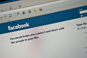 The Facebook homepage is seen on a compu